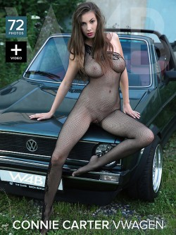 Connie Carter in black fishnet bodystocking posing on the hood of a Volkswagen | Watch4Beauty