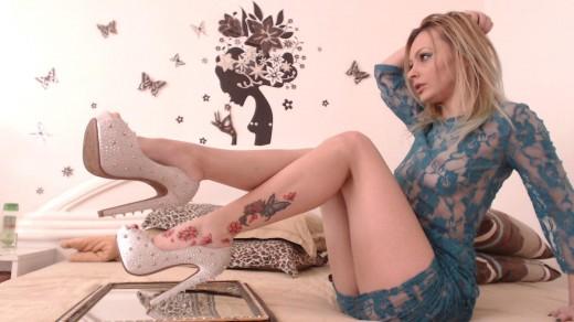 Michelyy from MyFreeCams in sheer mini dress & high heels