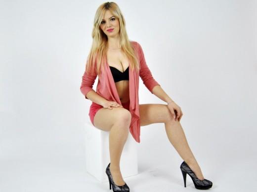 blonde cam babe NoraShy in high heels