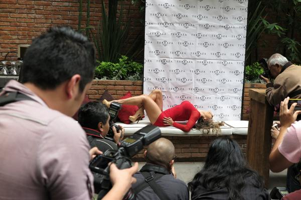 Esperanza Gomez in sexy red mini dress at Playboy México press conference