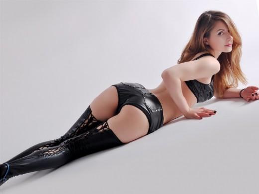 LexieRose wearing leather hotpants, bra & stockings