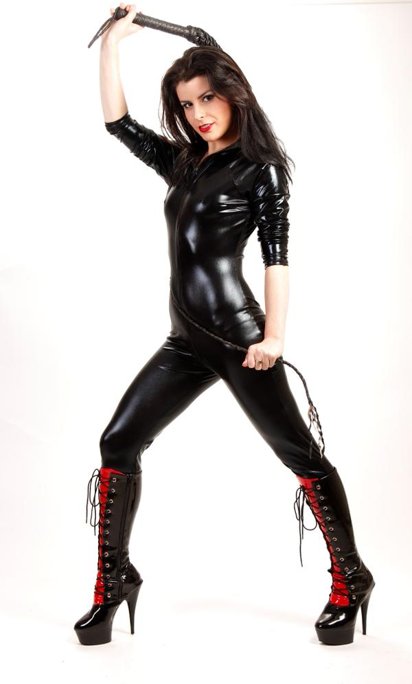 MFC KickAz in leather outfit & boots handling a whip