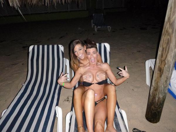Val Midwest gives a handbra to Brandy at the beach