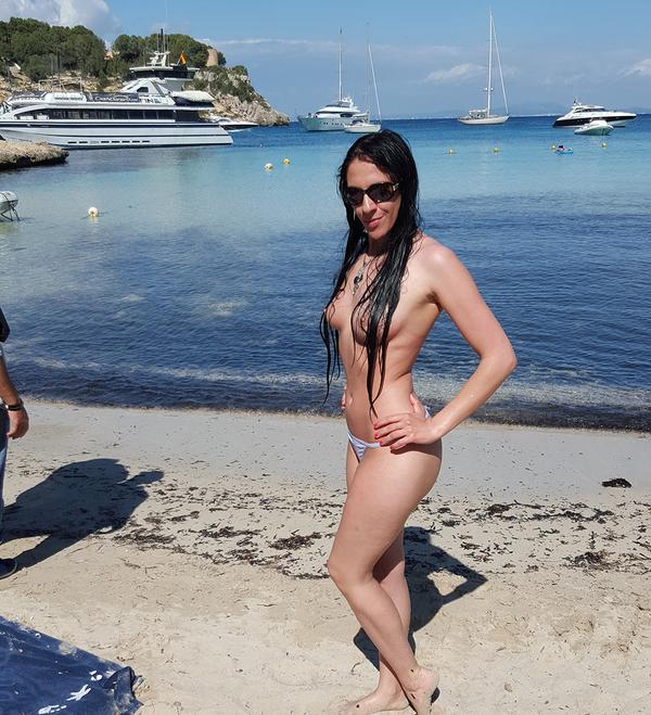 Sweet Sophie topless on beach in Mallorca, Spain