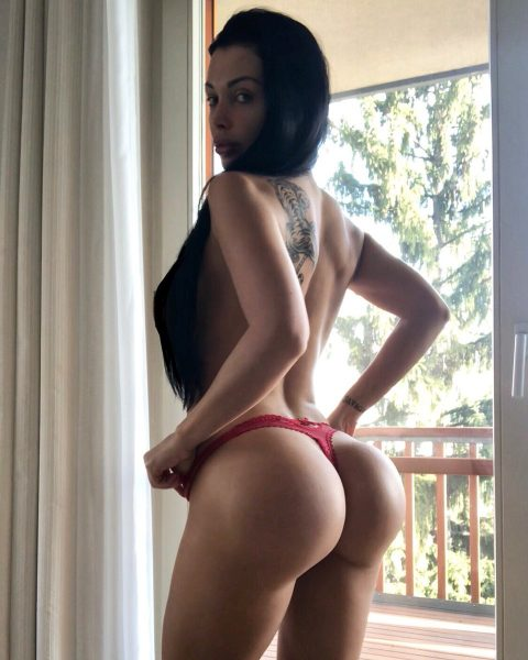 Aletta Ocean shows off her bubble butt in red thong