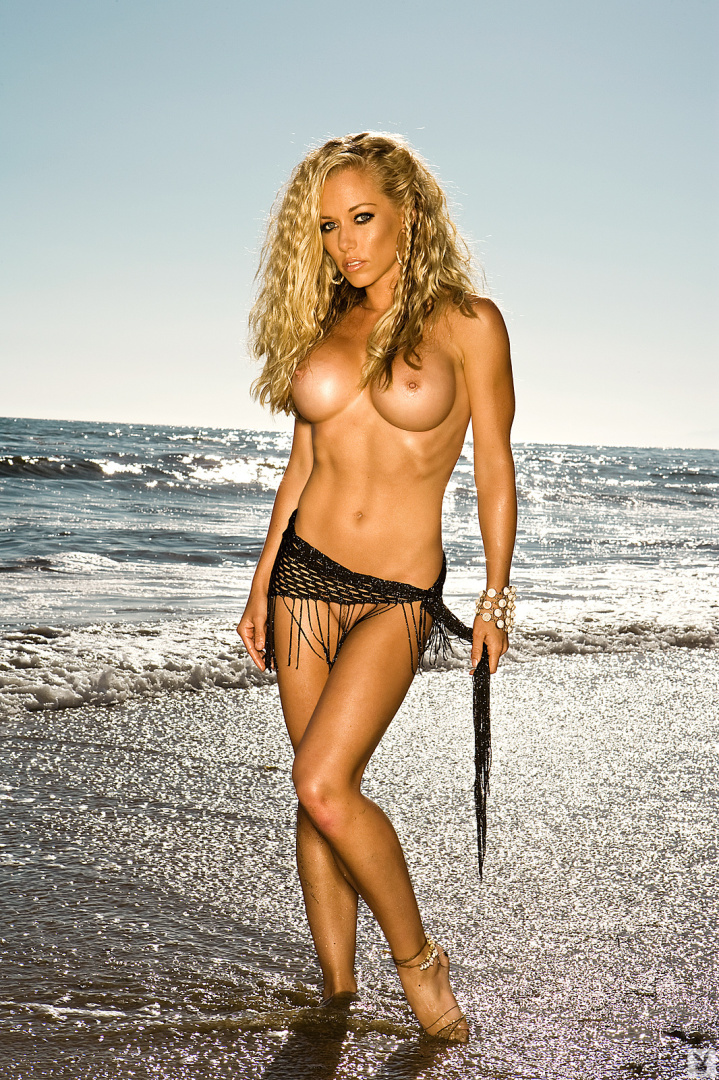 reality TV star Kendra Wilkinson poses nude at the beach for Playboy