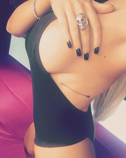 sideboob selfie by Cara Brett