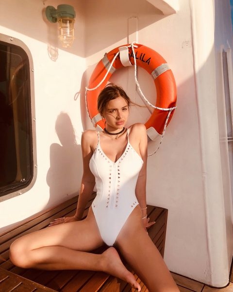 Sophie Mudd in white swimsuit