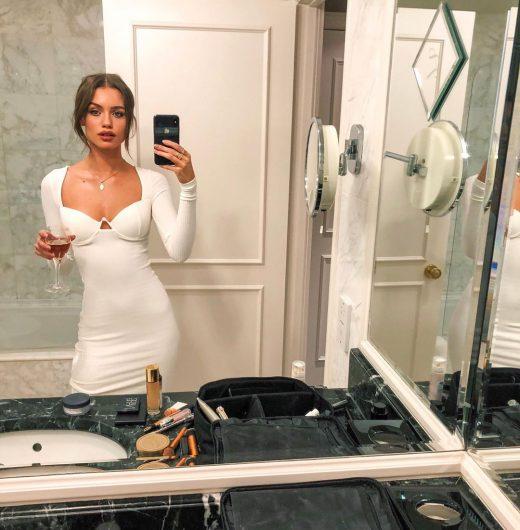Elle Trowbridge in dress takes selfie