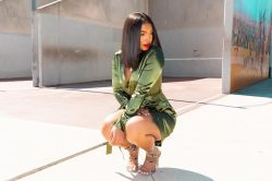 Lori Harvey in green dress