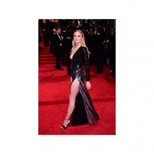 Sophie Turner on red carpet wearingLouis Vuitton