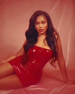 Jordyn Woods in red latex mini dress