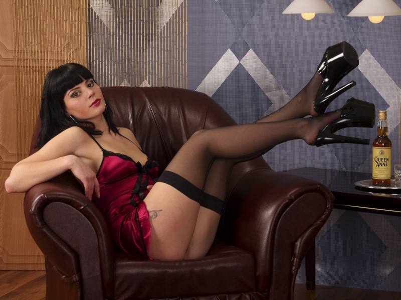 SweetAdriana from Xcams wearing a satin negligee & stockings with high heels