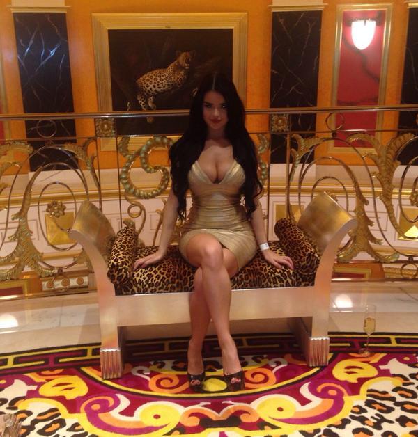 Demi Rose Mawby in tight golden mini dress