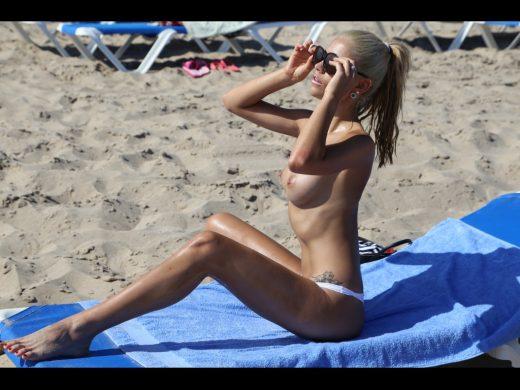 busty camgirlBrigitteLaszlo topless at beach