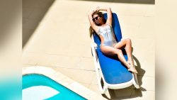 camgirl AwesomeKery suntanning in silver one piece swimsuit