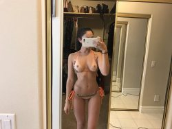 topless Ariana Marie with tanlines