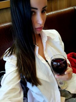 adult model Alyssia Kent drinking some red wine